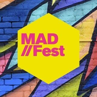 Image showing MAD//FEST logo against a colourful wall